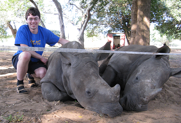 Alexander Burrows with rhinos in South Africa